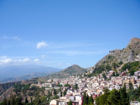 Taormina flanked by mountains