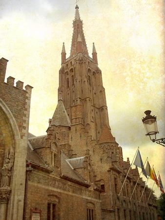 Medieval church building in Brugge, Belgium  Artistic picture in retro style