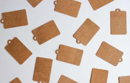 Kraft decorative cardboard paper gift price tags background. 版權商用圖片