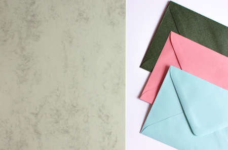 Colorful envelopes and cardboards on table. Mockup. Office concept.
