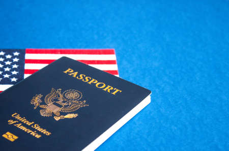 American flag and passport on blue background. Independence Day concept, 4th of July.