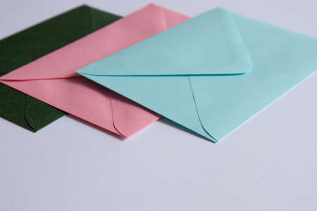 Colorful envelopes and white cardboard on table. Mockup. Office concept. 版權商用圖片 - 125897790