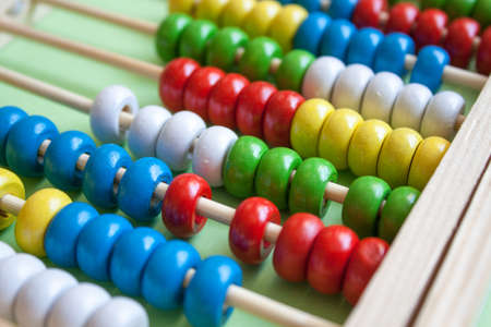 Colorful wooden abacus calculator background. Back to school concept.
