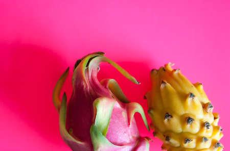Dragon fruits pitahaya on neon pink background.