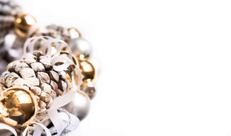 Silver and golden ornaments Christmas wreath on white background. Modern festive concept.