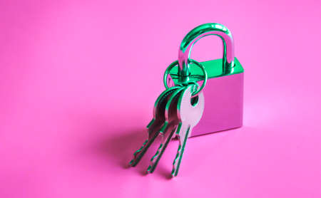 Silver shiny padlock and three keys on vibrant lilac pink gradient holographic color. Concept art. 写真素材