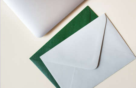 Colorful envelopes, laptop and cardboards on table. Mockup. Office concept.  版權商用圖片