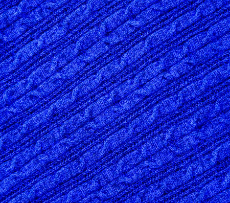 Blue knitted textile texture background. Warm cozy clothes concept.