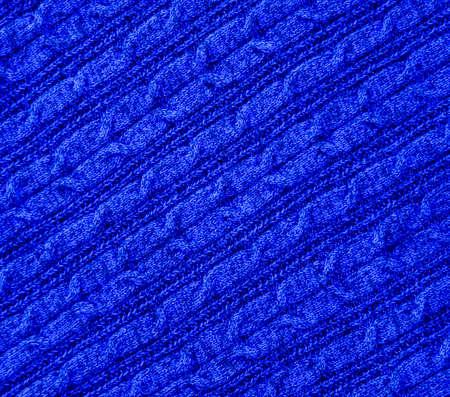 Fond de texture textile tricoté bleu. Concept de vêtements chauds et confortables.