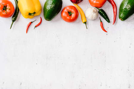 Different colorful fresh veggies frame background, top view healthy food concept.