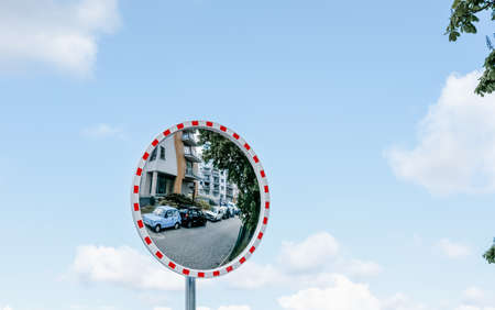 Reflective convex mirror for traffic safety, road mirror in Europe. 免版税图像