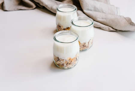 Healthy breakfast set with coffee, homemade yogurts with granola, honey or agave syrup.