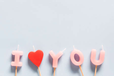 I Love You candles on pastel blue background. Valentines day concept background.