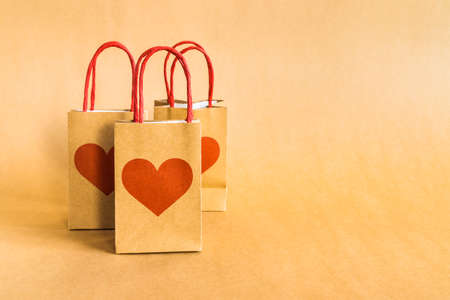 Valentines Day concept. Shopping paper bags with hearts print background.