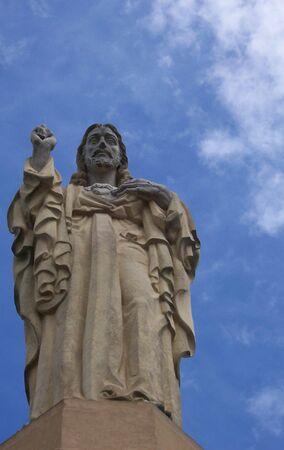 Jesus Statue, Taken in San Sebastian, Spain, Used clone stamp to removed flag pole. Reklamní fotografie - 3693188
