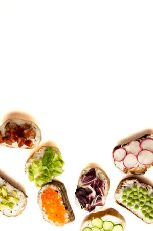 sandwiches or tapas prepared with bread and tasty ingredients. Could be nice food for healthy breakfast ot lunch. Copy space for your text on top