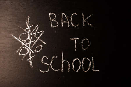 Back to school, the concept of parenting. The inscription on the blackboard with white chalk. Place for text. Copy space.