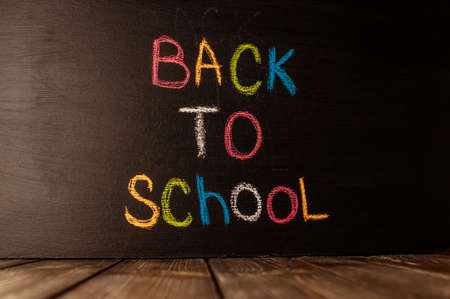 Back to school, the concept of parenting. The inscription on the blackboard colored chalk.