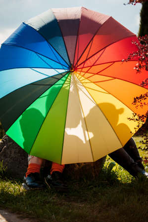 young couple of girls. Girls in love with lgbt umbrella. Two kissing girls Concept. Silhouette of two girls in love. Stockfoto