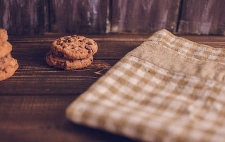 Oatmeal liver lies near the napkin in the box. Rustic table. Vintage toning. Dietary useful cookies without gluten. Copy space.