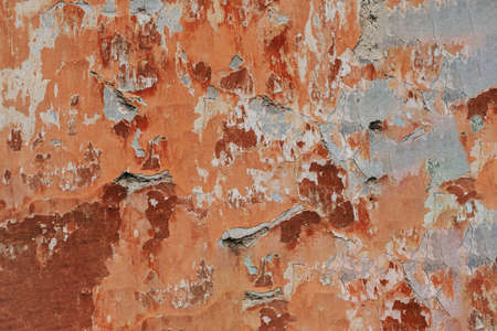 Multicolored background:concrete surface with peeling and cracked brown paint Natural defects Scratches,cracks,crevices,chips,dust,roughness,abrasion.Template for design and background.Copy space Imagens