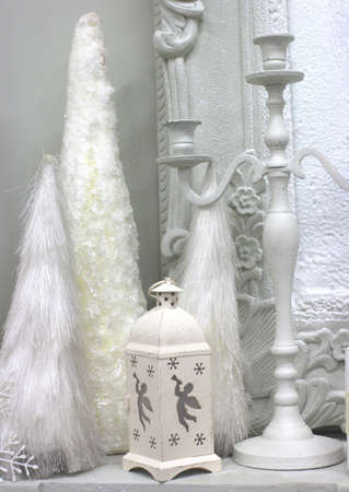 white decorative lantern candlestick with elements decorates the interior with toys