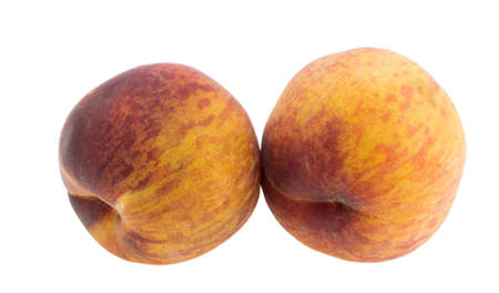 useful: Large juicy peaches. Useful dietary and vegetarian food. Stock Photo