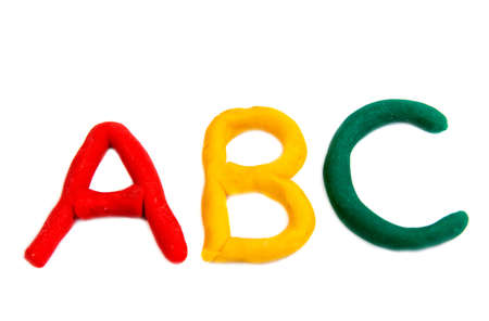Colored letters from plasticine isolated on white background