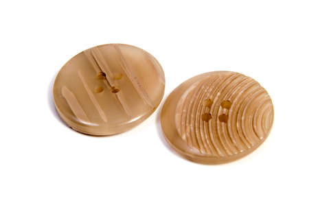 old items: Single brown clothing button isolated over the white background