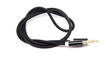 mini jack: black sound cable with 3.5 mm audio jack isolated on white background Stock Photo