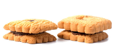 Peanut butter cookie on a white background. Golden homemade biscuit with a missing bite and trail of crumbs.