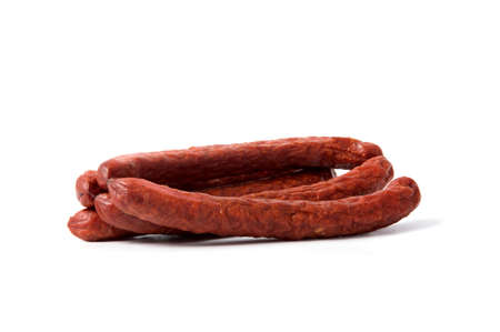 Small smoked sausages isolated on a white background.