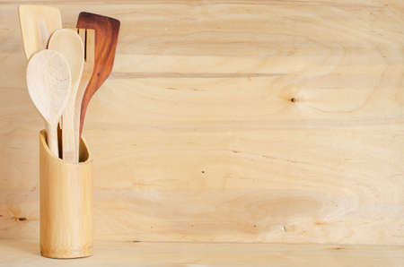 vintage cutlery: Home Kitchen Decor: vintage cutlery in a bamboo container on a wooden board background, rustic style.