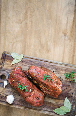 Fresh Raw Marinated Meat on a Wooden Table. Selective Focus. Top View. Stock Photo
