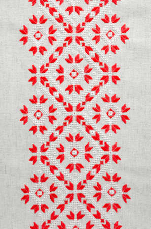Element handmade embroidery on linen by red and white cotton threads. Vintage texture design. Design of ethnic pattern. Stock Photo