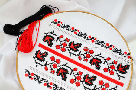 Slavic Cross Stitch by Red and Black Threads in the View of Viburnum. Ukrainian Folk Embroidery Pattern. Hemming. Stock Photo