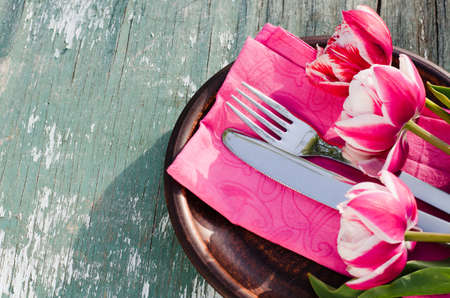 Festive Table Setting With Pink Tulips. Holliday Table Set for Mothers Day or Birthday. Selective Focus.