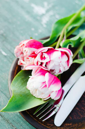 Festive Table Setting With Pink Tulips. Holiday Table Set for Mothers Day or Birthday. Selective Focus. Stock Photo