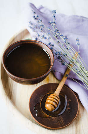 Organic honey and lavender flowers on wooden table. Rustic stile. Stock Photo