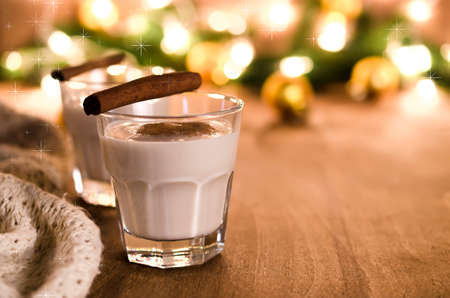 Traditional Winter Eggnog With Milk, Rum and Cinnamon, Sprinkle with Grated Nutmeg for Christmas Eve and Winter Holidays. Selective Focus Stock Photo