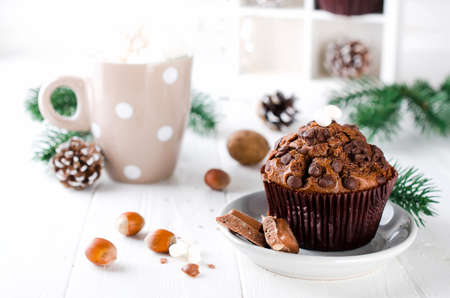 Christmas chocolate muffin and cocoa with marshmallow on white table. Xmas decoration. Selective Focus. Copy space Stock Photo