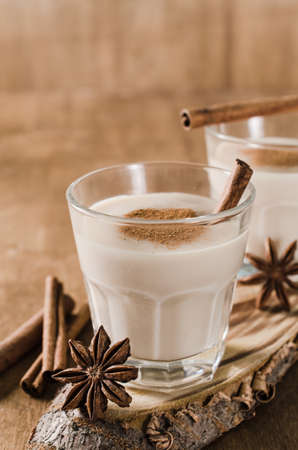 Traditional Homemade Winter Eggnog Cocktail with Whipped Cream and Cinnamon for Christmas Eve and Winter Holidays. Selective Focus. Copy Space Stock Photo
