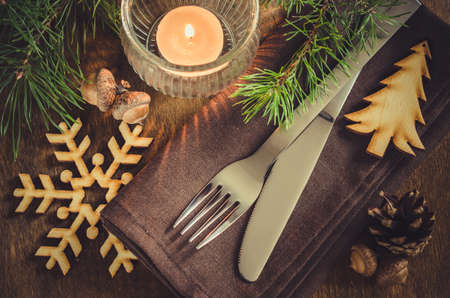 stock photo vintage or rustic christmas table setting with candle and wooden decorations cutlery on linen napkin on rustic wooden background country - Rustic Country Christmas Table Decorations