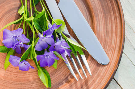 Festive Table setting with delicate purple flowers. Holiday Table Set for Mother's Day or Birthday. Selective Focus. Spring time