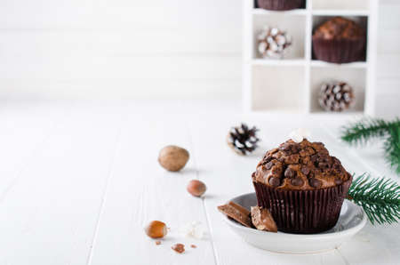 Chocolate muffin on white wooden background. Selective Focus Copy space
