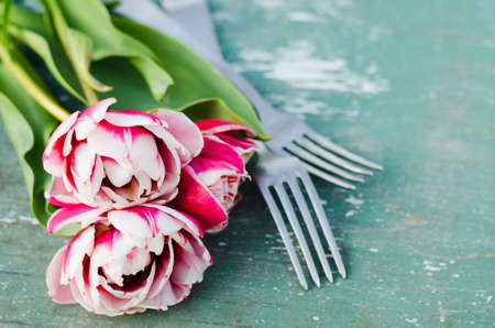 Festive Table Setting With Pink Tulips. Holiday Table Set for Mother's Day or Birthday. Selective Focus. Stock Photo