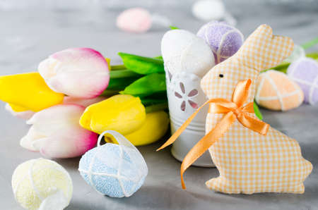 Happy Easter composition. Easter bunny, eggs and tulips. Space for text