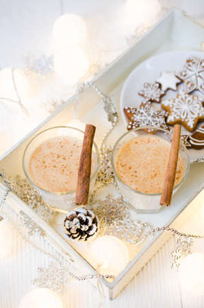 Christmas Traditional Homemade Eggnog and Gingerbread Cookies on White Background. Christmas Milk Cocktail with Spice. Selective Focus. Copy Space. Stock Photo