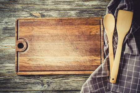 Culinary background with rustic kitchenware on vintage wooden table.