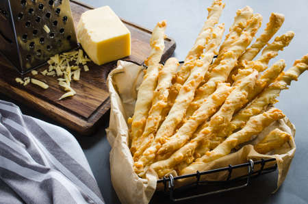 Cheese stick. Breadsticks with cheese on dark background, concept for snack or party time Reklamní fotografie